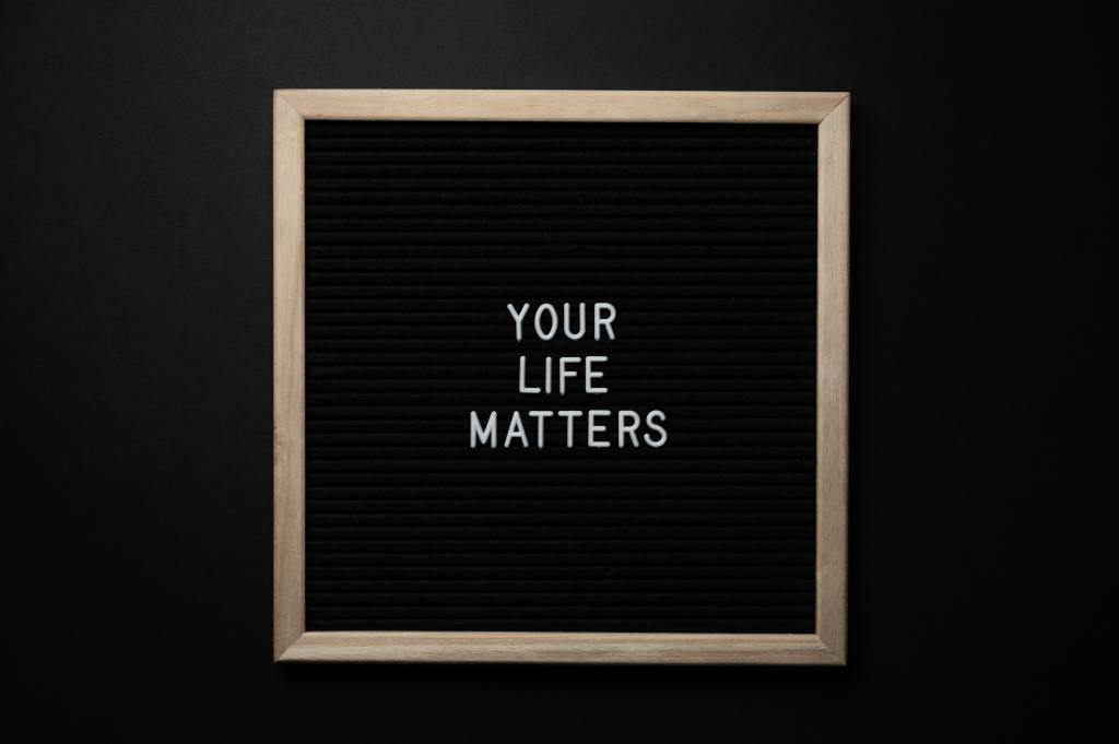 "Black sign board with white text that says, ""YOUR LIFE MATTERS"""